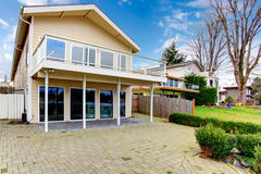Two story paneled house with glass balcony Royalty Free Stock Images