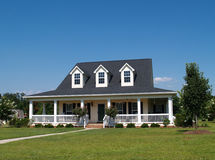 Two Story Residential Home. With vinyl or board siding on the facade Stock Photos