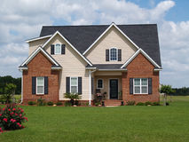 Two Story Residential Home. With both brick and board siding on the facade Royalty Free Stock Photography