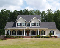 Two Story Residential Home. With with board siding on the facade Stock Images