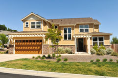 Two story single family house with driveway Royalty Free Stock Images