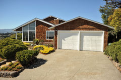 Two story single family house with driveway Stock Photography