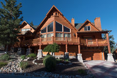 Two story single family  log house with driveway Stock Photography
