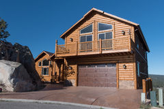 Two story single family  log house with driveway Stock Photos