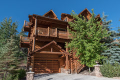 Two story single family  log house with driveway Royalty Free Stock Photography