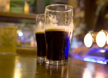 Two stouts on bar Stock Image