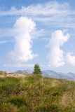 Two strange clouds, Val di Scalve, Italy. Panorama of the alps in summer royalty free stock photos