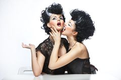 Two strange women posing Stock Photos