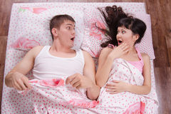 Two strangers awake in bed Royalty Free Stock Image