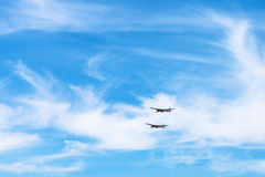 Two strategic bomber aircrafts in white clouds Stock Image