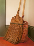 Two Straw Brooms Stock Images