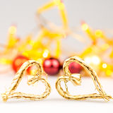 Two straw christmas hearts on white background Stock Photography