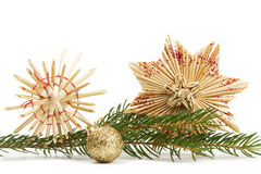 Two straw stars and christmas ball with branch Stock Photography