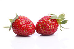 Two strawberries with big eyes and lips kissing Royalty Free Stock Photos