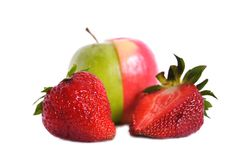 Two strawberries and green apple Stock Images
