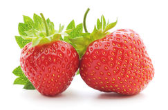 Two strawberries with leaf Stock Image