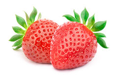 Two strawberries with leaves isolated Stock Photography
