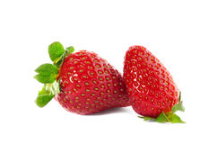 Two strawberries on white background Royalty Free Stock Images
