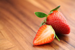 Two of strawberry. Close-up of strawberries on wood Stock Photography