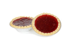 Two strawberry tarts in foil cups Stock Photos