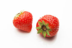 Two strawberrys on white Royalty Free Stock Image