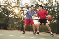 Two street basketball players on the basketball court stock photography