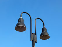 Two street lamps in the daytime Royalty Free Stock Photos