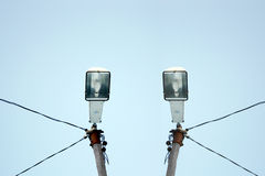 Two street lights  in clear blue sky Stock Images