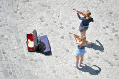 Two street musicians playing violin Royalty Free Stock Image