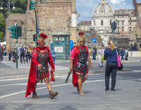 Two street performers costumed as legionaries Stock Photography