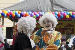 Two street performers in white wigs royalty free stock images
