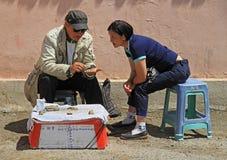 Two street sellers are conversating in Ulaanbaatar Royalty Free Stock Image