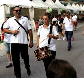 Two street smiling musicians walking with their instruments. Elche, Alicante, Spain; on October 14, 2018: Two street smiling musicians, a man and a woman royalty free stock photos
