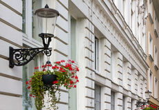 Two Streetlamps on a Historic Building's Facade Stock Photography
