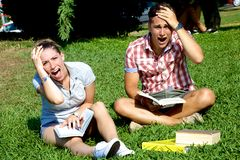 Two stressed out students shouting Stock Photo