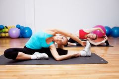 Two stretching girls Royalty Free Stock Images