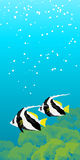 Two striped coral fishes under water. Two striped Moorish idol fishes floating under water. Vertical banner Royalty Free Stock Image