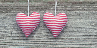 Two Striped Fabric Hearts Royalty Free Stock Photography