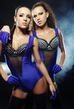 Two  striptease girls over dark background Stock Photography