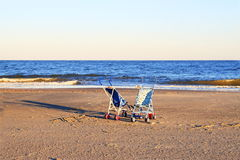 Two strollers on beach Royalty Free Stock Photos