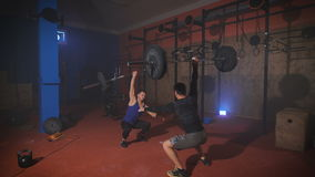 Two strong man doing weightlifting workout at the gym. stock footage