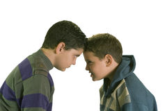 Two stubborn boys arguing. Two stubborn boys isolated on white background Royalty Free Stock Images