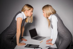 Two stubborn business women. Having an argument Royalty Free Stock Photo
