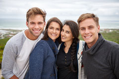 Two student couples smiling outdoors in nature Stock Photography