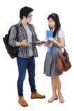 Two student discussing homework Royalty Free Stock Photos