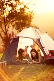Two girlfriends enjoying in camping trip. Two student girls  enjoying in camping trip in countryside stock images