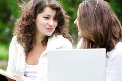 Two student girls with laptop Stock Images