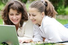 Two student girls on nature Stock Image