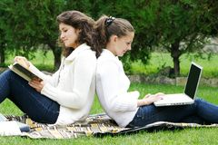 Two student girls on nature Royalty Free Stock Photography