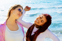 Two student girls at the sea Stock Image